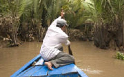 activity En sampan dans le Delta du Mékong