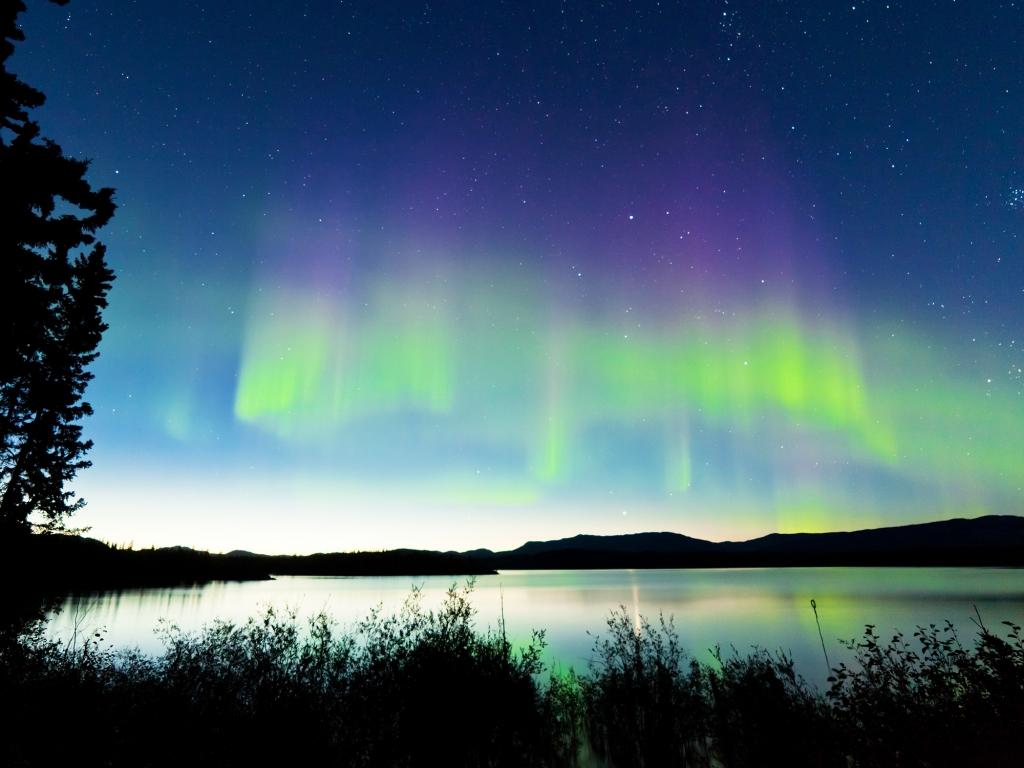 Fjords et aurores boréales à Sommarøy