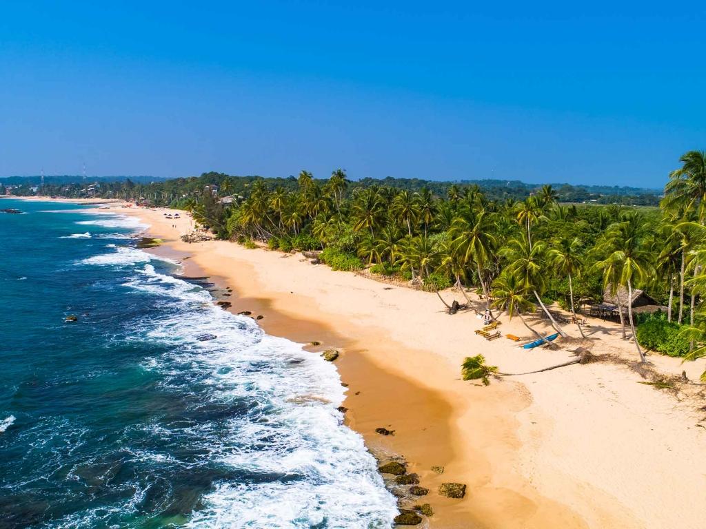 Les pieds dans l'eau dans l'océan Indien